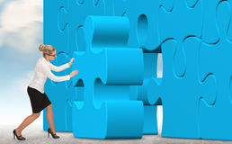 Business woman building a puzzle on a sky background Stock Photos