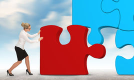 Business woman building a puzzle on a sky background Stock Images