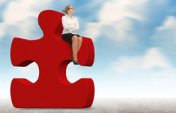 Business woman building a red puzzle on a sky background. Royalty Free Stock Photo