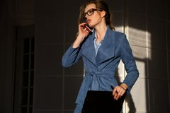 Business woman in business attire in the negotiations Stock Images