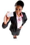 Business woman with business card. This is an image of a business woman presenting a business card Royalty Free Stock Images