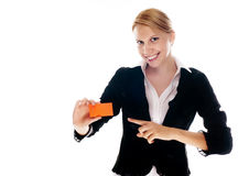Business woman with a business card. On a white isolated background Stock Image