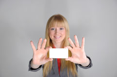 Business woman with a business card Royalty Free Stock Image