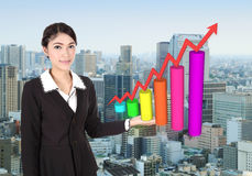 Business woman with business graph Royalty Free Stock Images