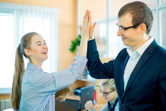 Business woman and business man give five Royalty Free Stock Photo