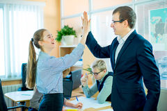 Business woman and business man give five Royalty Free Stock Images