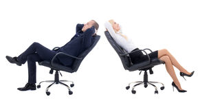 Business woman and business man sitting on office chairs isolate. Business women and business men sitting on office chairs isolated on white background Stock Photo