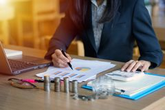 BusiBusiness woman or business owner while working. Young business owner with calculator. Business woman or business owner while working. Young business owner royalty free stock photos
