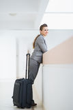 Business woman in business trip with wheel bag Stock Photography