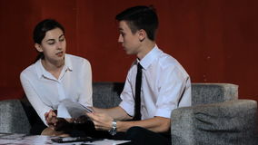 Business woman and businessman talking on the work in the office stock video footage