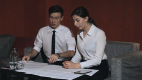 Business woman and businessman talking on the work in the office stock footage