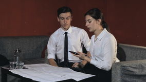 Business woman and businessman talking on the work in the office stock video