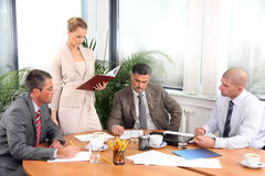 Business woman and businessmen working Stock Photos