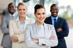 Business woman with businesspeople. Happy business women with group of businesspeople on background royalty free stock images