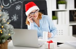 Businesswoman freelancer working at a computer at Christmas Stock Photos