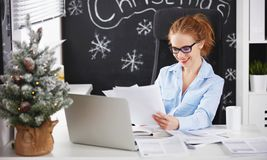 Businesswoman freelancer working at a computer at Christmas Royalty Free Stock Images