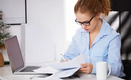 Businesswoman freelancer working at a computer at Christmas Royalty Free Stock Photography