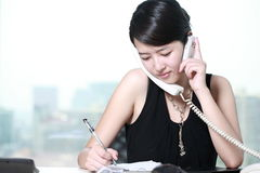 Business woman busing on phone Royalty Free Stock Photos