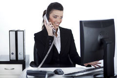 Business woman busy at office Stock Photos