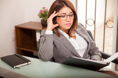 Business woman busy at work Royalty Free Stock Photo