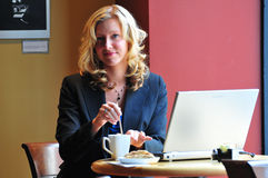 Business woman in a cafe Stock Images