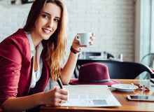 Business woman in a cafe Royalty Free Stock Photography