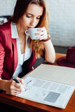 Business woman in a cafe Stock Image