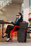 Business woman in cafe at station Stock Photography