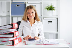Business woman calculates tax Royalty Free Stock Photography