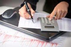 Business woman calculating Stock Photos