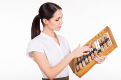 Business woman calculating finance with abacus Royalty Free Stock Images