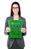 Business woman with a calculator Stock Images