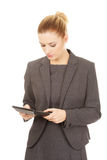 Business woman with a calculator. Royalty Free Stock Image