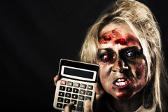 Business woman with calculator. Halloween sale Stock Images