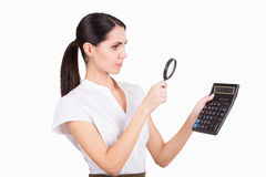 Business woman with calculator and loupe Royalty Free Stock Photos