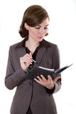 Business woman with calendar. A picture of a business woman with a appointmant calendar Royalty Free Stock Image