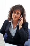 Business woman call. Business woman making call with mobile phone royalty free stock photography