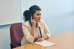 Business woman call to inquire more details about document. And thinking Royalty Free Stock Photos