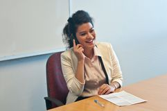 Business woman call to inquire more details and talk. Over a mobile phone Stock Images
