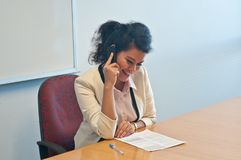 Business woman call to inquire more details and talk. Over phone to discuss more information Royalty Free Stock Images