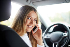 Business woman calling in car Stock Photo