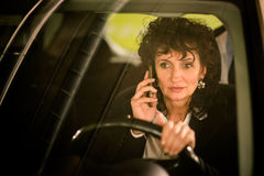 Business woman calling and driving Stock Images