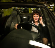 Business woman calling and driving Royalty Free Stock Image