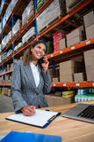 Business woman calling on her desk Stock Image