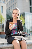 Business woman calling phone - problems. Young depressed business woman calling with mobile phone - negative expression Royalty Free Stock Photos