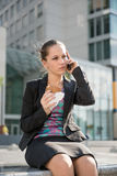 Business woman calling phone - problems. Young depressed business woman calling with mobile phone - negative expression Royalty Free Stock Photo