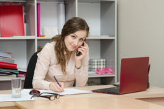 Business woman calling by phone in the workplace Stock Photo