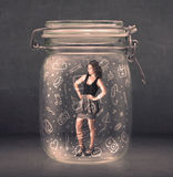 Business woman captured in glass jar with hand drawn media icons Royalty Free Stock Images