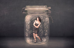 Business woman captured in glass jar with hand drawn media icons. Concept on background Royalty Free Stock Images