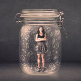 Business woman captured in glass jar with hand drawn media icons. Concept on background Stock Images